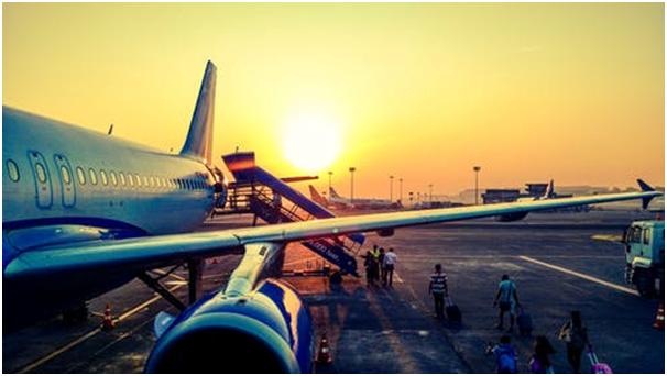 The picture shows an aircraft parked on the tarmac of an unnamed airport .