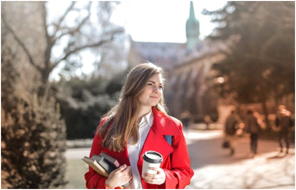 A female student apparently starting her day with a cup of coffee.