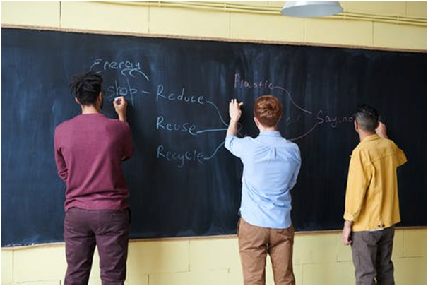 Three student taking part in a class work.