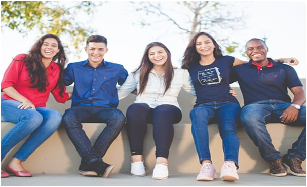 Five students from different cultural background are in a jovial mood.