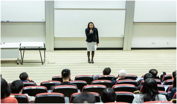 A female lecturer at the lecture theatre.