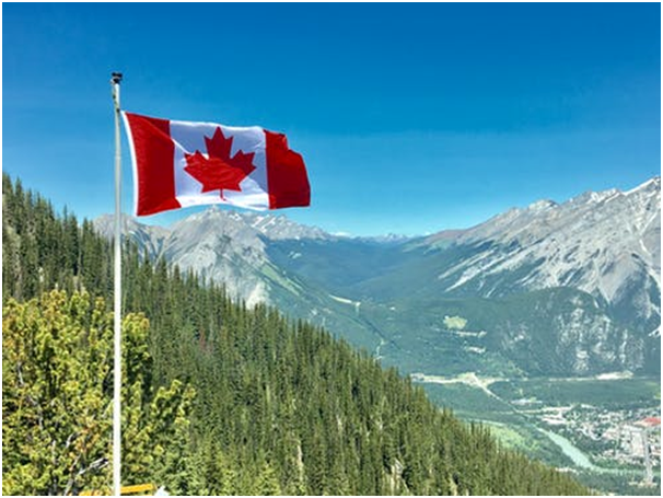 Picture shows the Canadian landscape with a flaunting national flag
