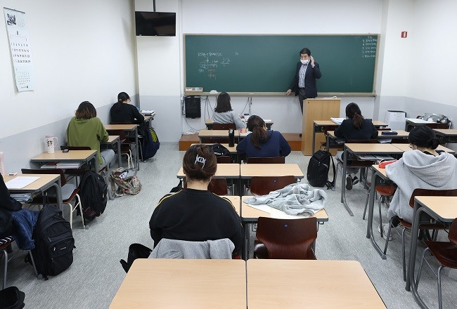 Watchdog Says Law Mandating Higher Education for Foreign Teachers Discriminatory